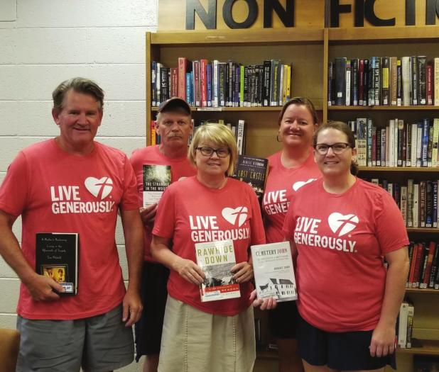 Thrivent Financial donates money for book drive
